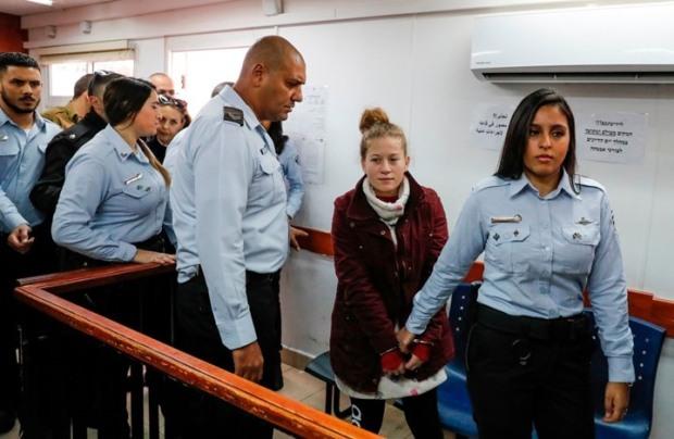 ahad-tamimi-handcuffed