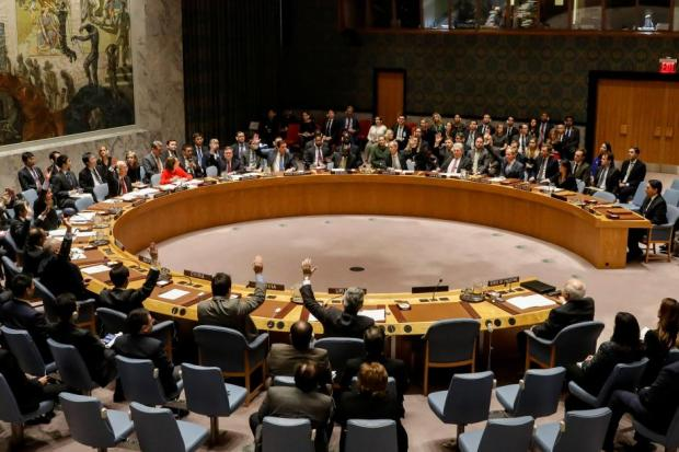 Members of the United Nations Security Council vote on an Egyptian-drafted resolution regarding recent decisions concerning the status of Jerusalem, during a meeting on the situation in the Middle East, including Palestine, at U.N. Headquarters in New York